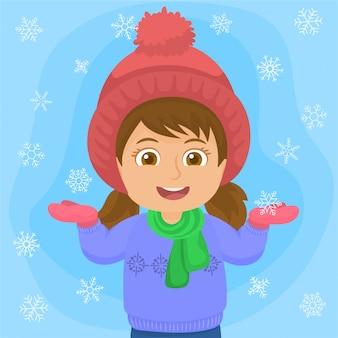 Kleines mädchen, das mit schneeflocken spielt