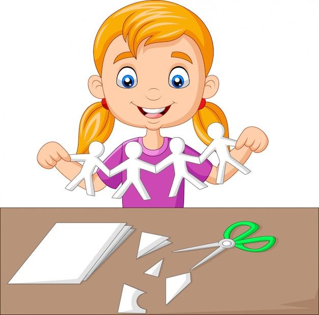 Kleines mädchen der karikatur, das papierleute bildet