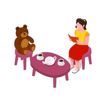 Kleines mädchen liest buch beim kaffeetrinken mit teddybär isometrisch