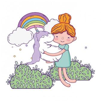 Kleines mädchen mit einhorn und regenbogen kawaii