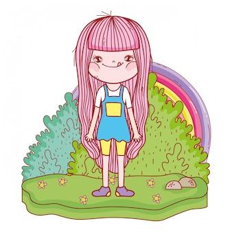 Kleines mädchen mit regenbogen in der landschaft