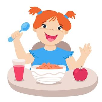 Kleines rothaariges mädchen frühstückt. süße zeichentrickfigur. gesundes essen. flache vektorgrafik mit lächelndem kind, tisch, löffel, apfel, glas saft und teller mit flocken.