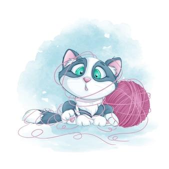 Kleines süßes kätzchen verheddert sich in einem wollknäuel.