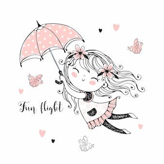 Kleines süßes mädchen, das auf einem regenschirm fliegt.