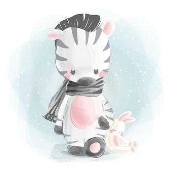 Kleines zebra und seine hasenpuppe