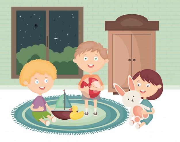 Kleinkindgruppe, die mit spielwaren im raum spielt