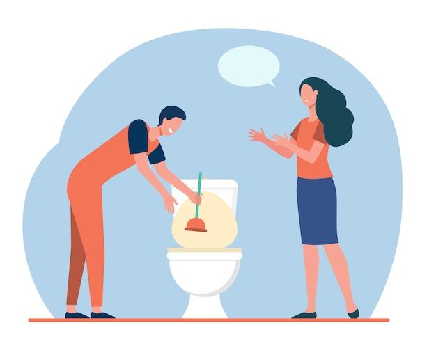Klempner, der toilettenwaschbecken von verstopfung reinigt