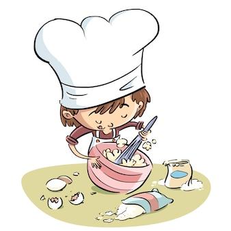 Kochjunge, der in einer schüssel wischt