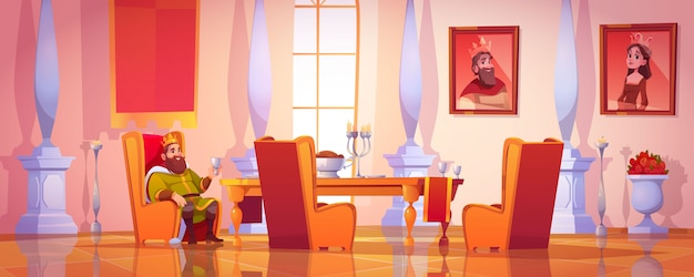 König hält becher, der am tisch mit essen sitzt