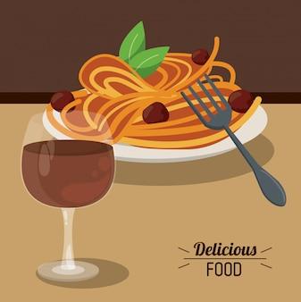 Köstliche essen spaghetti fleischbällchen und glas tasse wein