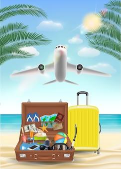 Koffer und sonnenbrille am meeresstrand