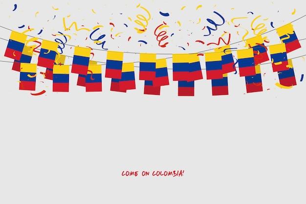 Kolumbien-girlandenflagge mit konfettis auf grauem hintergrund.