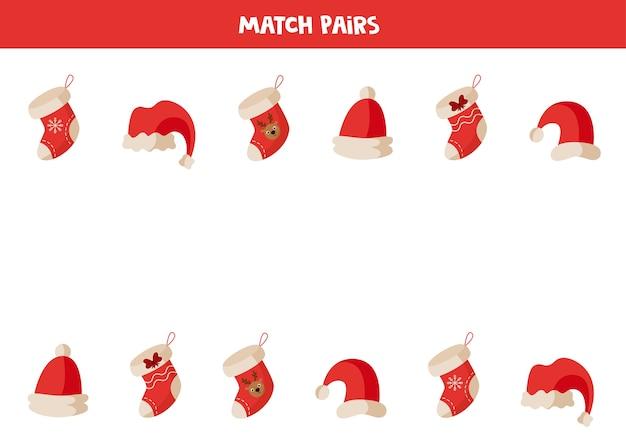 Kombinieren sie ein paar weihnachtssocken und weihnachtsmützen. ein logisches lernspiel für kinder