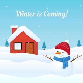 Kommender hintergrund des winters mit nettem gekleidetem schneemann und grußkarte des schneebedeckten hauses