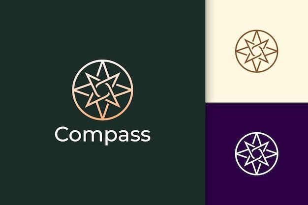 Kompass-logo im modernen und luxuriösen stil mit goldfarbe