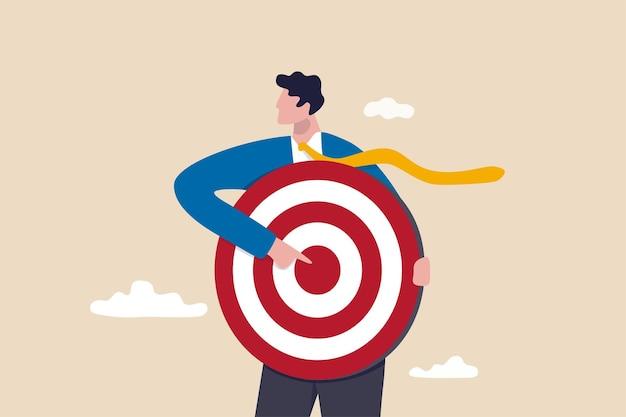 Konzentrieren sie sich auf das geschäftsziel, setzen sie sich ein ziel für die motivation, eine zielgruppe für werbung oder einen zweck für das karriereentwicklungskonzept, einen geschäftsmann, der ein bogenschützenziel oder ein dashboard hält, das auf bullseye zeigt.