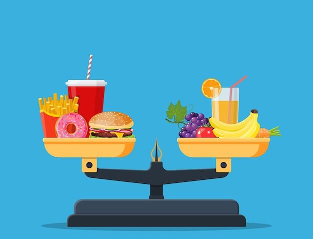 Konzept der gewichtsabnahme, gesunde lebensweise, ernährung, richtige ernährung. gemüse und fast food auf waagen.