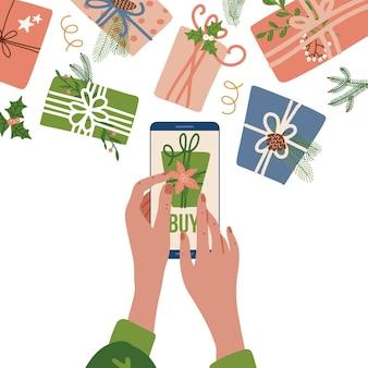 Konzept der online-bestellung von weihnachtsgeschenken weibliche hände, die mobiltelefon mit zusatz zum auto halten ...