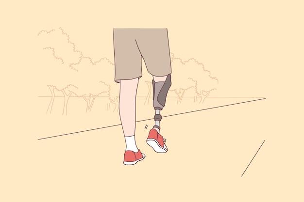 Konzept des aktiven lebensstils von behinderten und behinderten menschen. niedrige winkelansicht am behinderten jungen mann mit dem beinprothesengehen