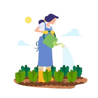 Konzept des biologischen landbaus mit der frau, welche die anlagen wässert