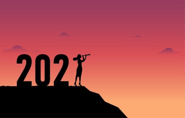 Konzept des neuen jahres 2021 und geschäftsentwicklung. geschäftsfrau mit einem teleskop.