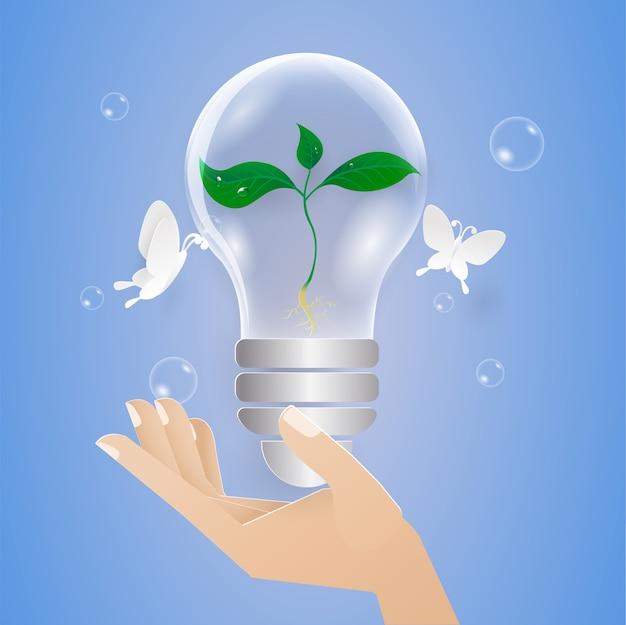 Konzept retten natur und bäumchen in glühbirne, zur hand. papierschnitt kunststil.