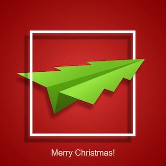 Konzept weihnachtsbaum und origami flugzeug