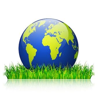 Konzept zum weltumwelttag. erdkugel auf grünem gras-design-hintergrund