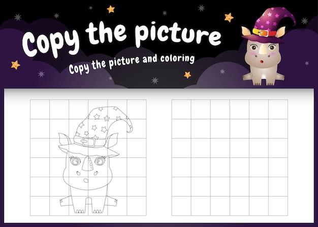 Kopieren sie das bild kinderspiel und die malvorlage mit einem süßen nashorn im halloween-kostüm
