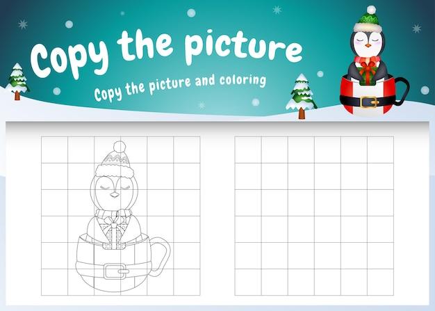 Kopieren sie das bild kinderspiel und die malvorlage mit einem süßen pinguin auf der tasse