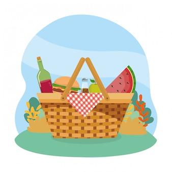 Korb mit weinflasche und hamburger und wassermelone