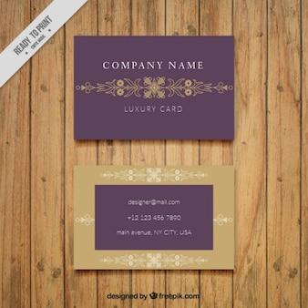Korporative visitenkarte mit einem goldenen rahmen