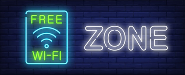 Kostenlose wi-fi zone leuchtreklame. drahtloses wav symbol im blauen rahmen auf dunkler backsteinmauer.