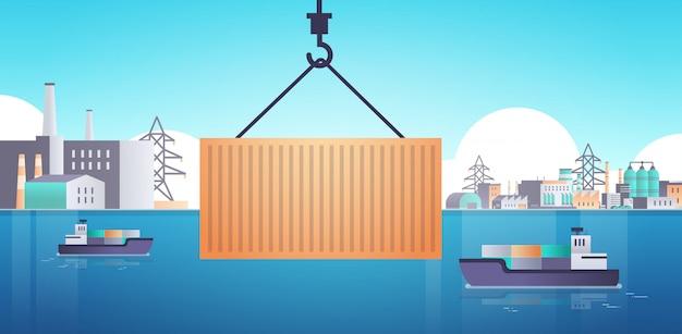 Kranhaken heben frachtcontainer box auf schiff über fabrikgebäude industriegebiet