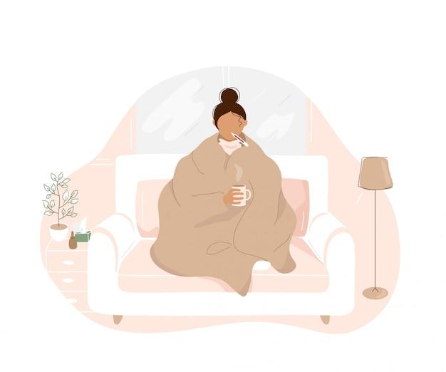 Kranke frau mit grippe sitzt auf sofa