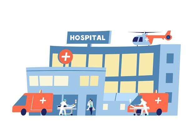 Krankenhausgebäude mit krankenwagen, die mit kranken leuten ankommen