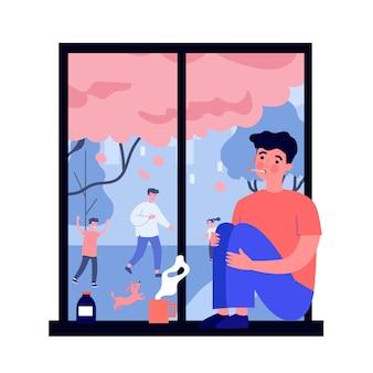 Kranker junger mann mit grippe, der fenster betrachtet