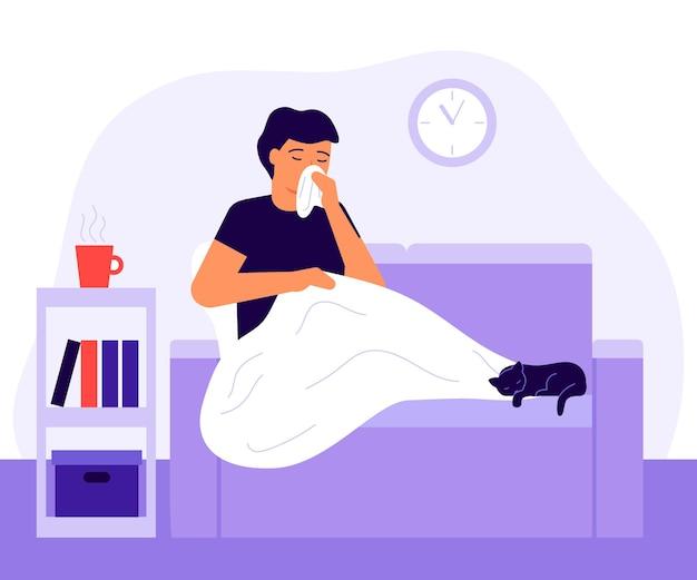 Kranker mann mit hohem fieber und allergie unter der decke auf der couch zu hause. männlicher kranker, der im bett liegt