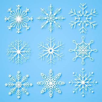 Kreative schneeflocken der frohen weihnachten stellten hintergrund ein