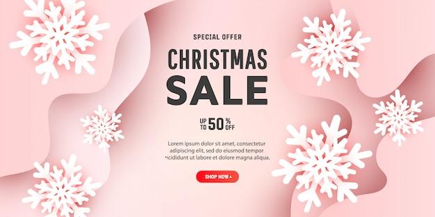 Kreative zusammensetzung der frohen weihnachten mit schneeflocken des papiers 3d und flüssiger welle formt auf einen leicht rosa hintergrund mit platz für text.