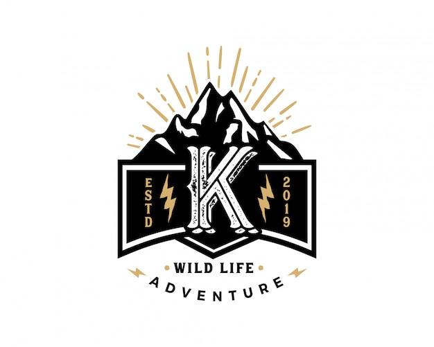 Kreativer retro- weinlesehippie des anfangsbuchstaben k und schmutzvektor-logo entwerfen