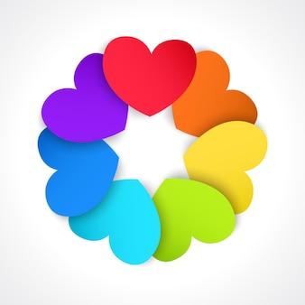 Kreis aus papierherzen, bemalt in allen farben des regenbogens
