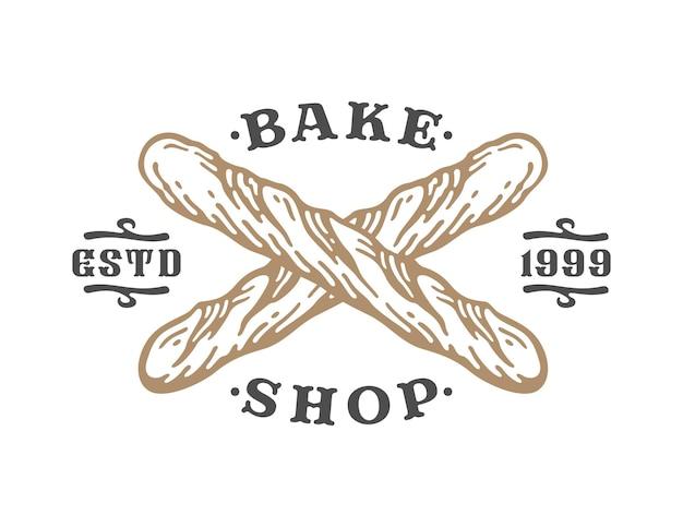 Kreuzförmiges baguettebrötchen im vintage-stil. label logo bäckerei.