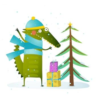 Krokodil, das warme winterkleidung trägt, die feiertag feiert