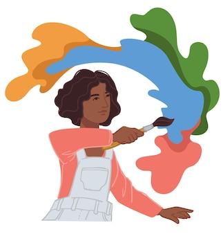 Künstlerfrau, die mit aquarellfarben malt