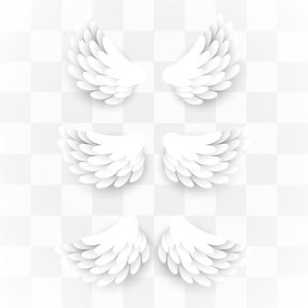 Künstliche weiße papierflügel auf transparent gesetzt