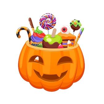 Kürbiseimer mit halloween-süßigkeiten