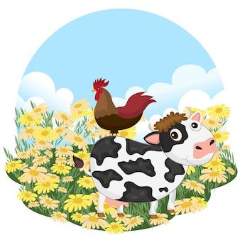 Kuh und hahn auf einer wiese