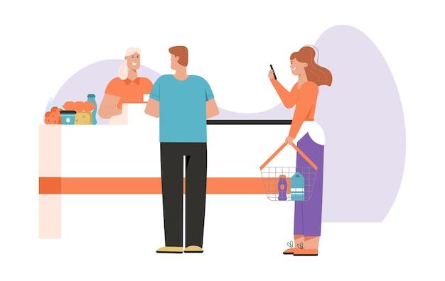 Kunden an der kasse im supermarkt.