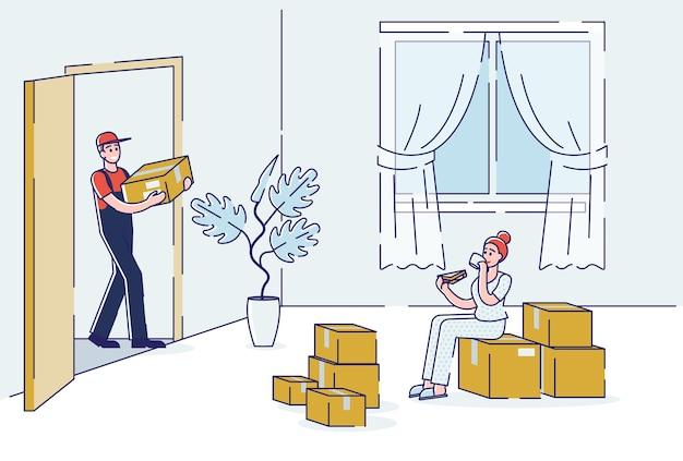 Kurier bringt pappkartons pakete im wohnzimmer für kundin der lieferung